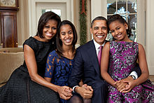 Official portrait by Pete Souza of the Obama family in the Oval Office, 11 December 2011